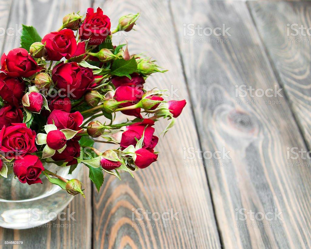Red roses in vase stock photo