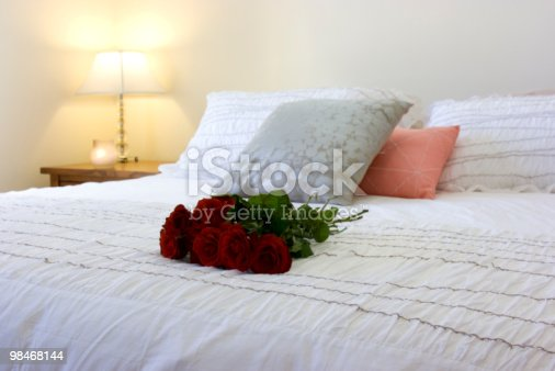 Red Roses On A Bed Stock Photo & More Pictures of Anniversary