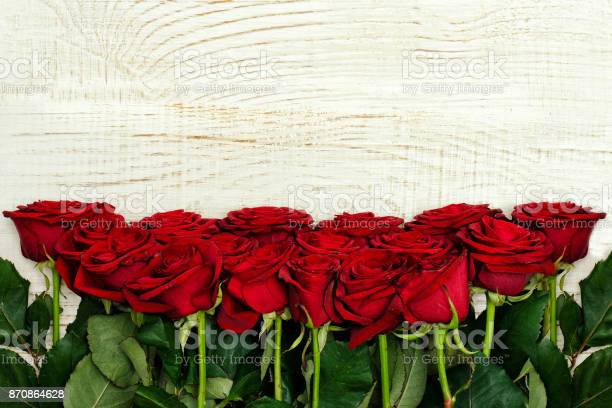 Red roses on a light wooden background top view picture id870864628?b=1&k=6&m=870864628&s=612x612&h=g2ifl dfvifmwnp0qulmykcslcutlhzgjerj9pwrtpi=