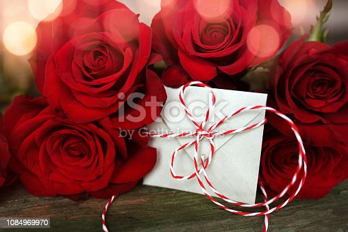 638784780 istock photo Red roses with a love letter 1084969970