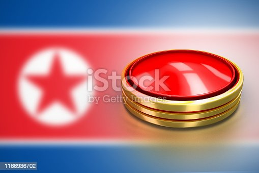 istock Red round button with gold border. North Korean lunch ICBM missile for nuclear bomb test 3d illustration concept. DPRK flag on broken crisis trump. 1166936702
