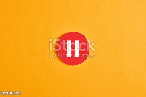istock Red round circle with a pause button or icon 1296161082