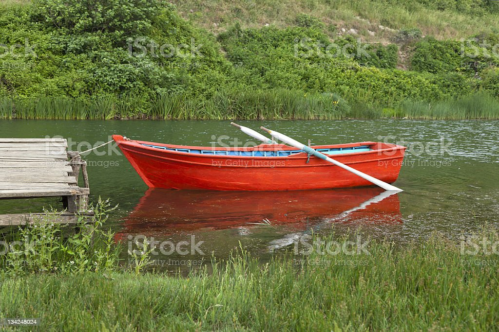 Red Rowing Boat On Water royalty-free stock photo
