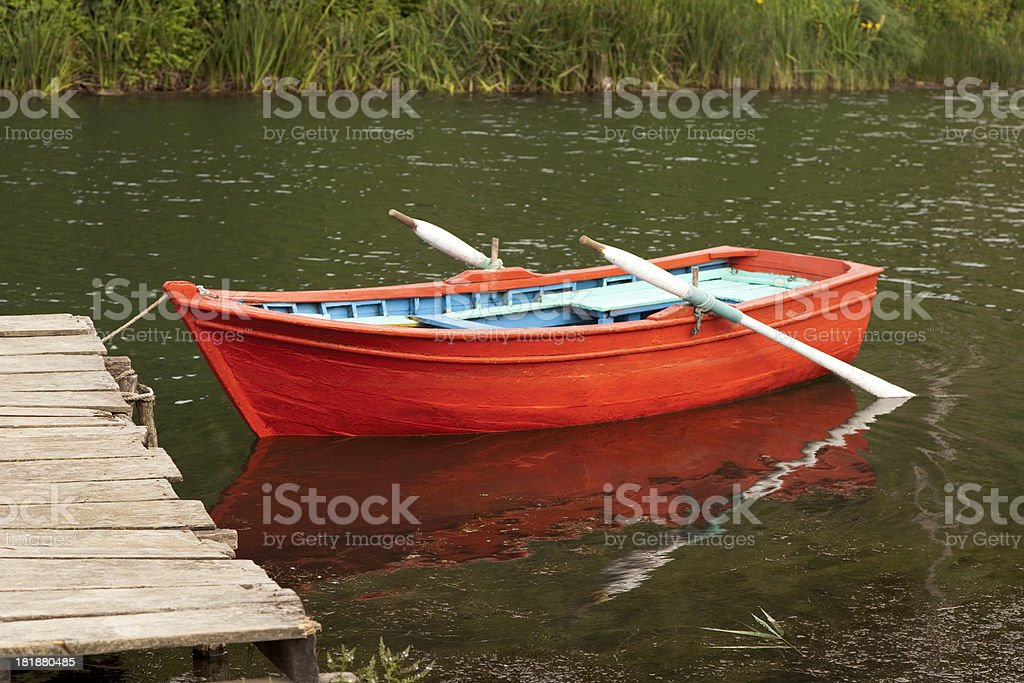 Red Rowing Boat On Water stock photo