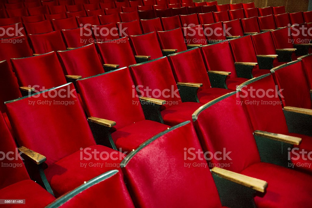 Red rows of seats in a theatre stock photo