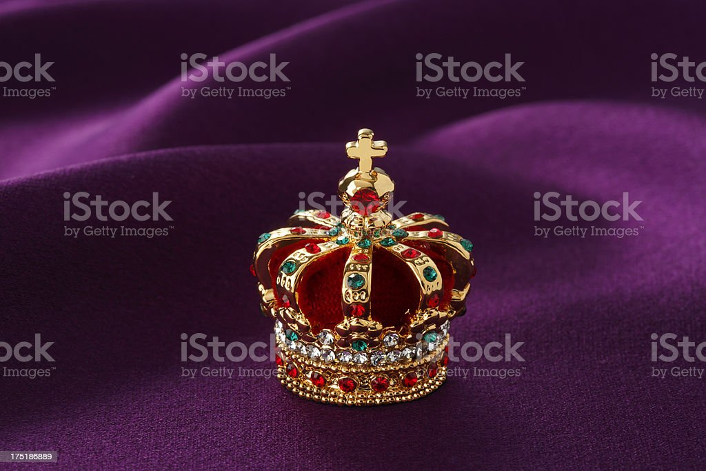 Red royal gold crown with various jewels stock photo