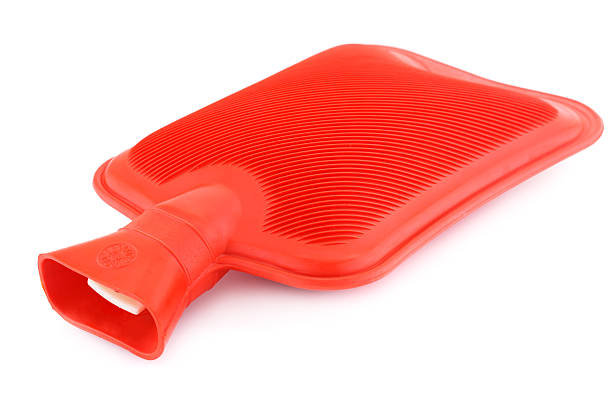 Red rubber hotty Red rubber hotty isolated on white background. hot water bottle stock pictures, royalty-free photos & images