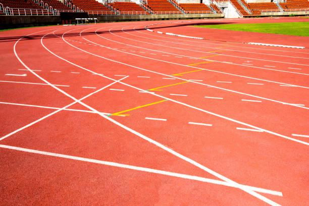 red running track on athletic stadium stock photo