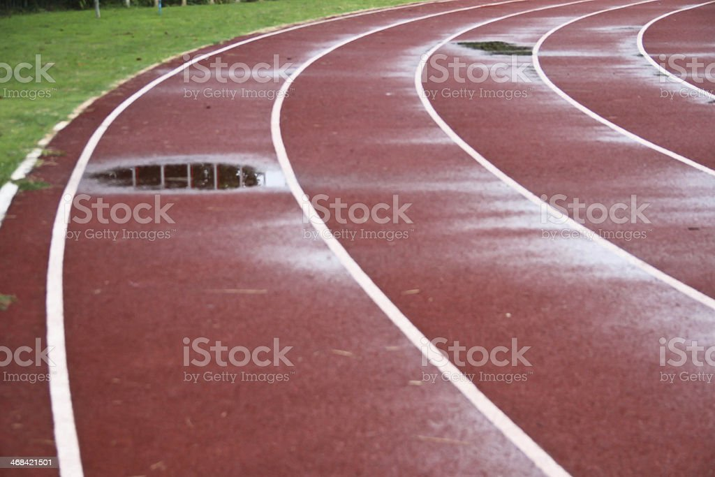 Red running track wet royalty-free stock photo