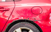 istock Red rusted and scratched car with damaged rusty paint in crash accident or parking lot and dented damage of metal body from collision 1144831183