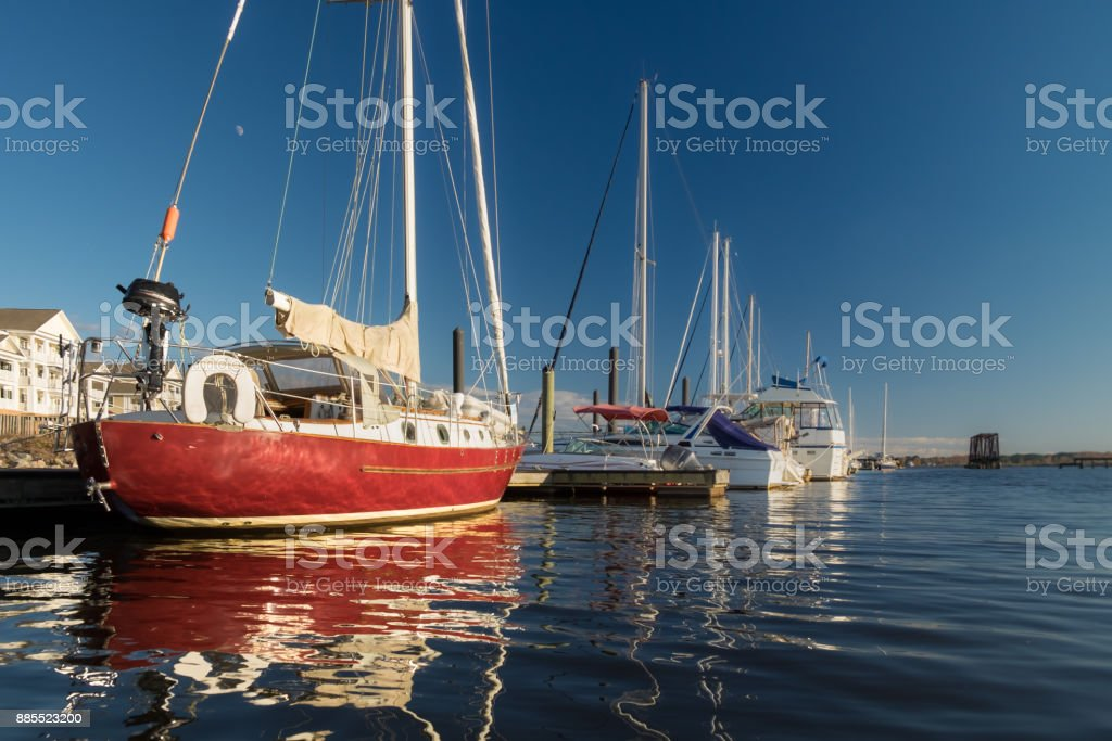 Red Sailboat in the Afternoon Sun stock photo