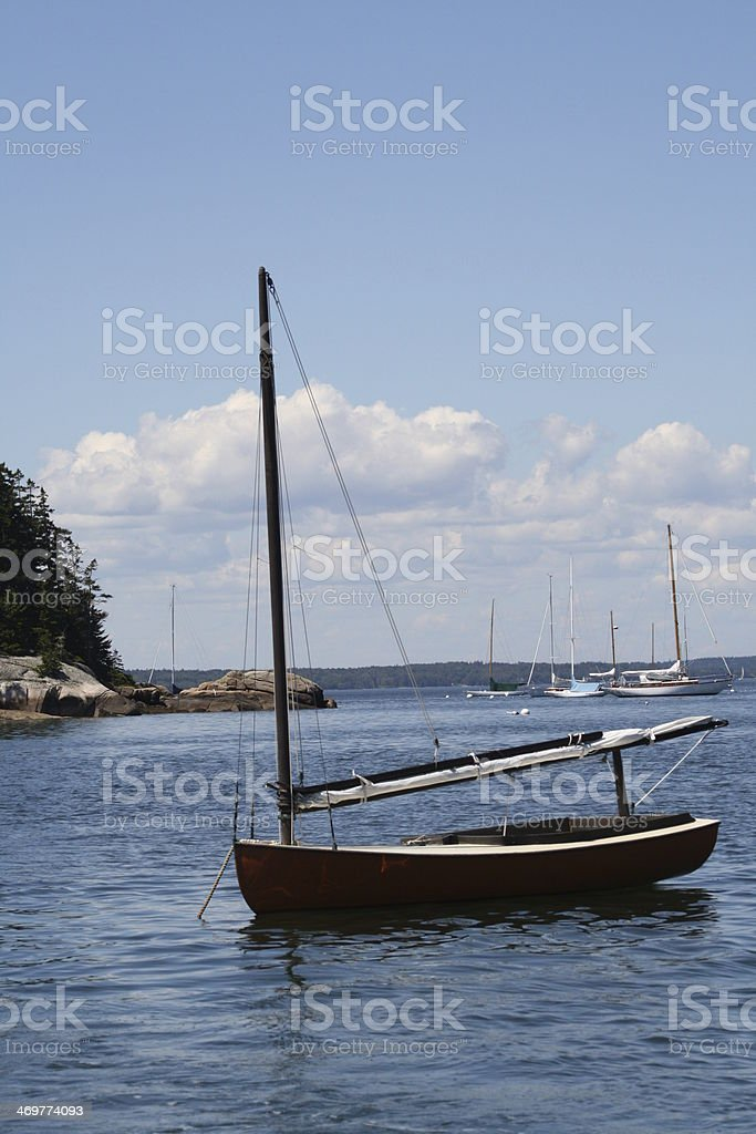 Red Sailboat Moored in a Maine Harbor royalty-free stock photo