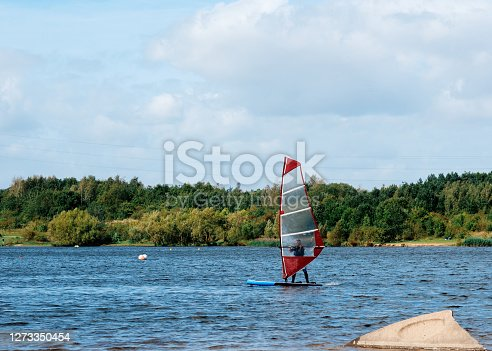 istock red sailboat on the lake 1273350454