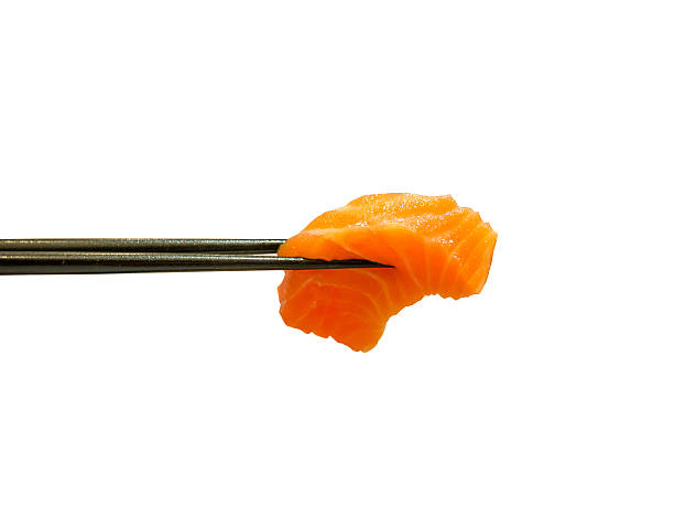 red salmon fish slice sashimi in chopsticks - japanisches essen stock-fotos und bilder