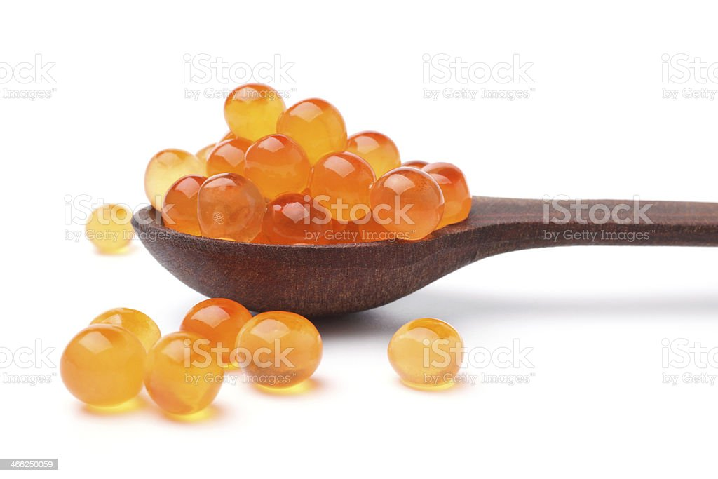 Red salted caviar with wooden spoon stock photo