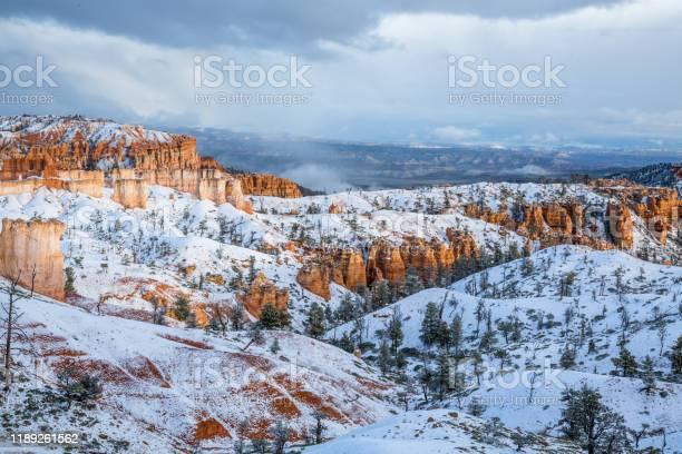 Photo of Red sandstone towers of Bryce Canyon, Cedar Breaks under fresh snow in Utah.