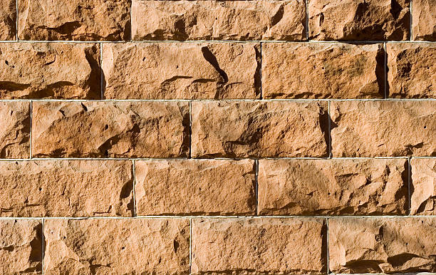 Red Sandstone Wall Textured Background stock photo
