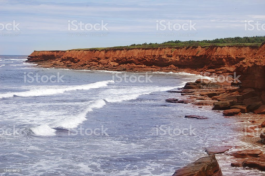 red sandstones at the Prince Edward Island beach stock photo