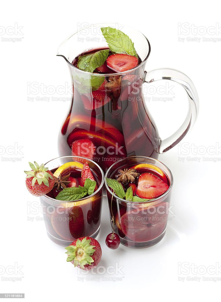 Red sangria wine in pitcher and glasses with fresh fruit royalty-free stock photo