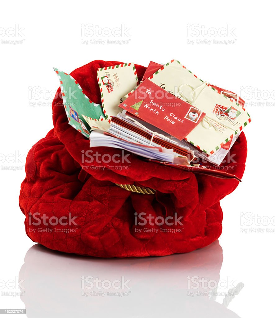 Red Santa Claus mailbag stuffed with letters stock photo