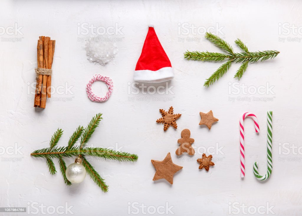 Red Santa Hat Cinnamon Sticks Fir Branches Gingerbread Cookies Xmas