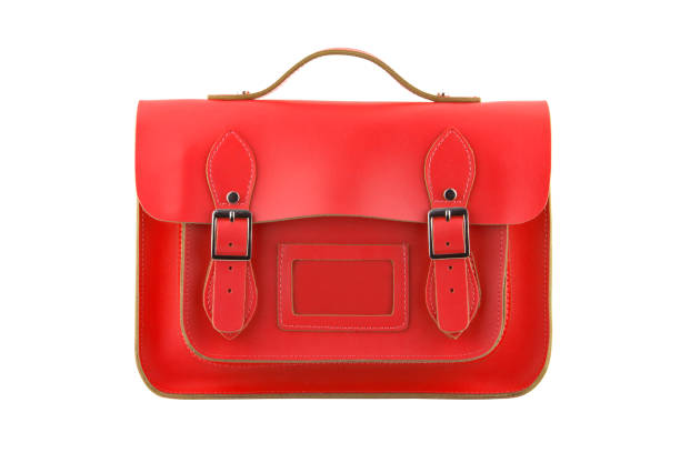 red satchel isolated on a white background with clipping path - cartella scolastica foto e immagini stock