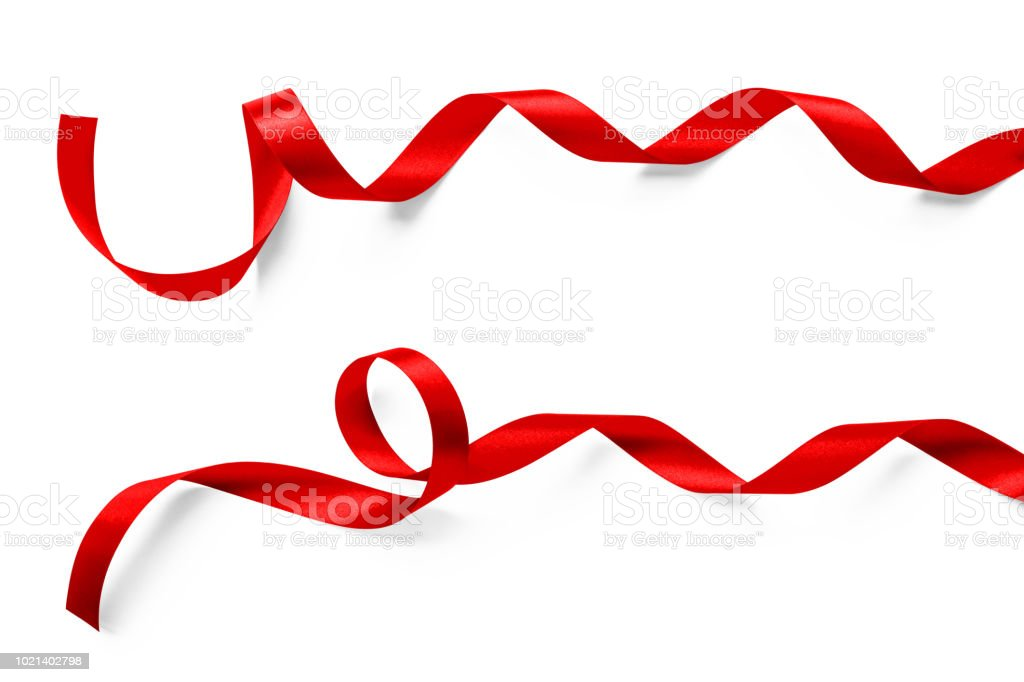 Red satin ribbon curly bow color isolated on white background with clipping path for Christmas holiday greeting card design decoration element