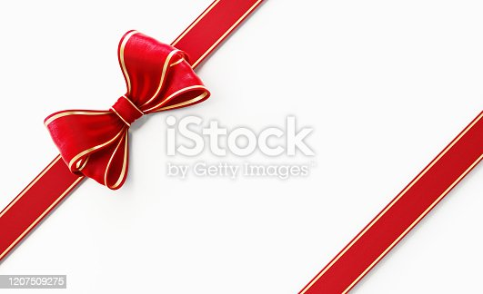 Red satin ribbon with gold linings on white background, Horizontal composition with clipping path. Gift concept.