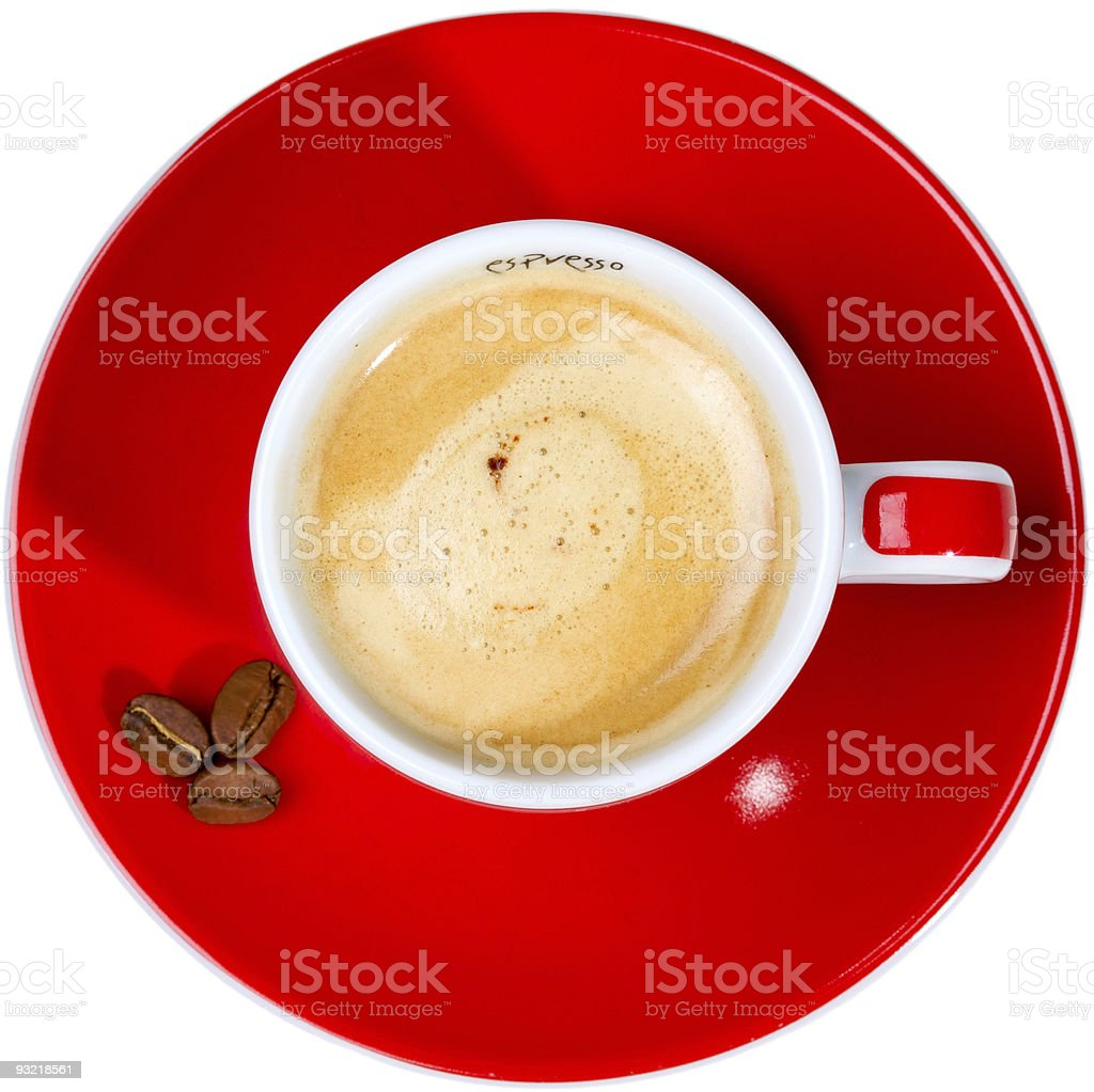 Red saucer with coffee beans and white and red cup royalty-free stock photo