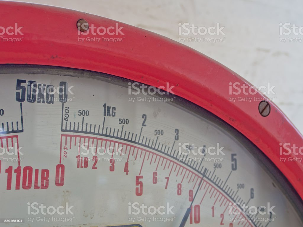 Red Scales - Colour Weighing Scales - Shipping Industry stock photo