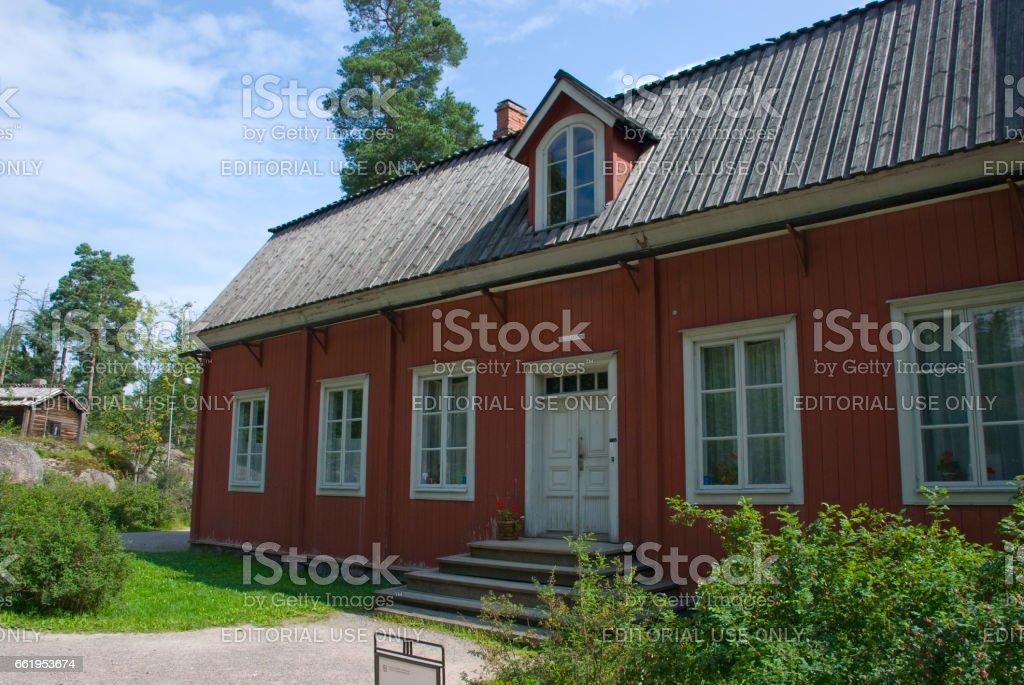 Red scandinavian wooden house - classical nordic architecture royalty-free stock photo