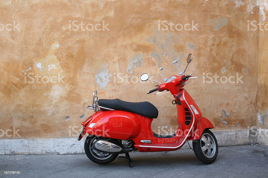 Red scooter and Roman wall, Rome Italy stock photo