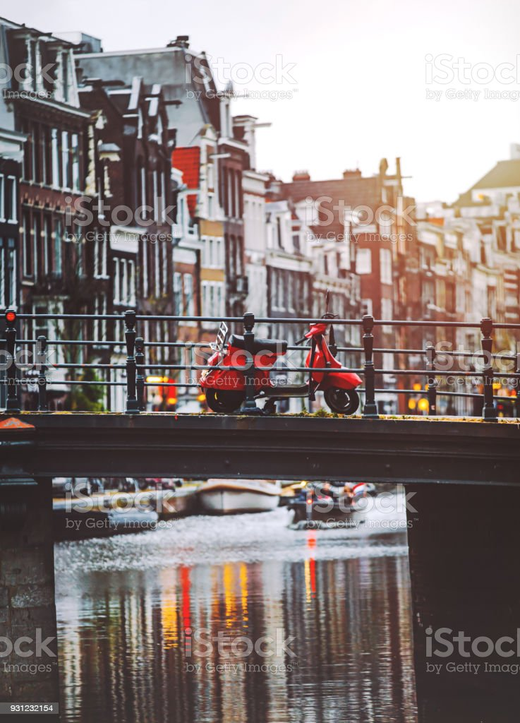 Red scooter parked on a bridge in Amsterdam stock photo