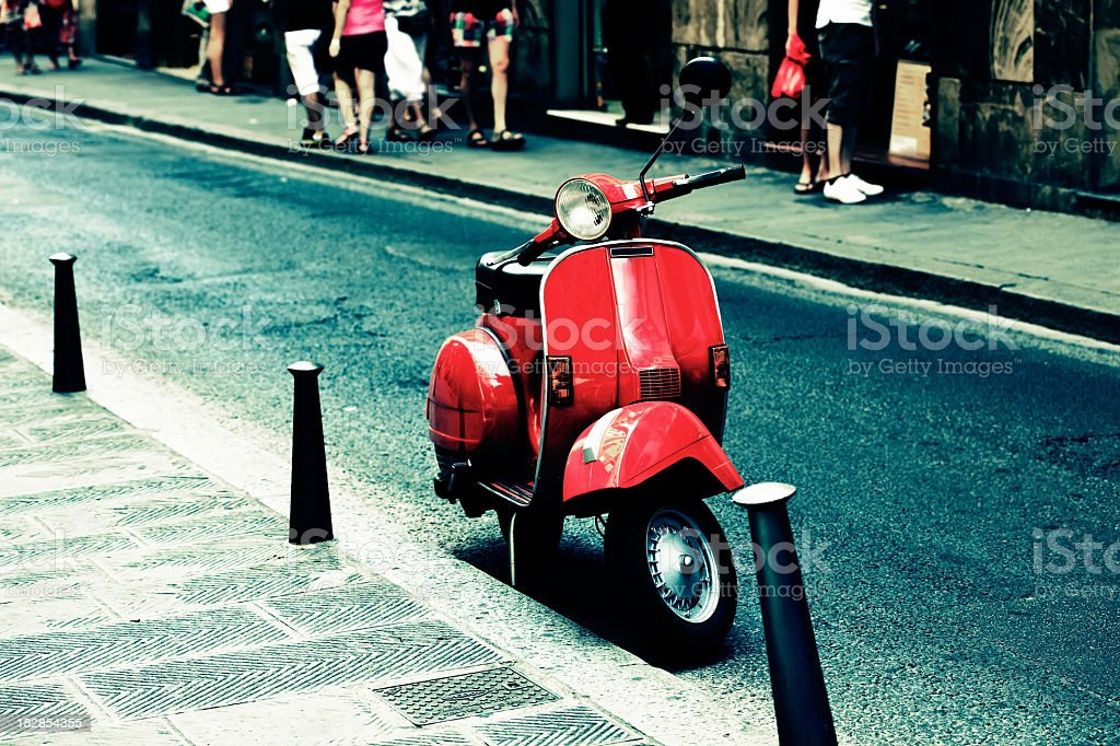 Red scooter parked on an Italy street stock photo