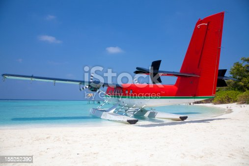 istock Red sea plane on a tropical beach 155252390