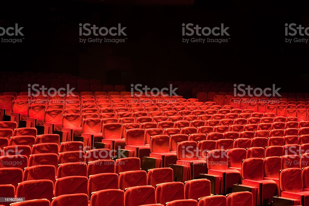 Red Seat Rows in Auditorium Movie Theater Seats stock photo