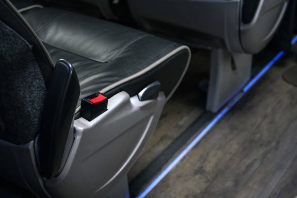 Red seatbelt clip at bus seat. Seat belts are compulsory on long distance coaches in UK stock photo