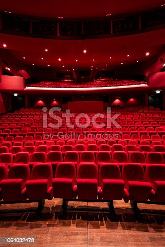 Cinema theater with Red Seats. Red and empty theater seats in a row