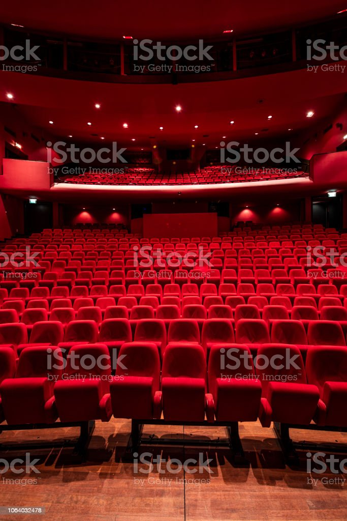 Red seats in theather stock photo