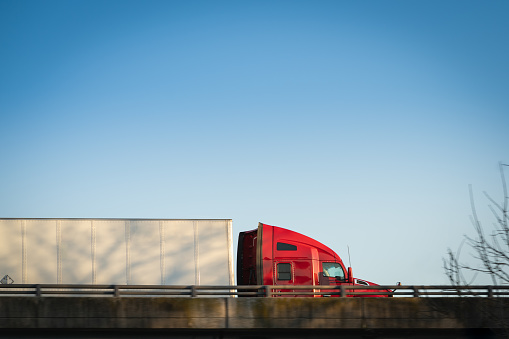 Red Semitruck 18 Wheeler On Highway Overpass Profile Stock Photo - Download Image Now