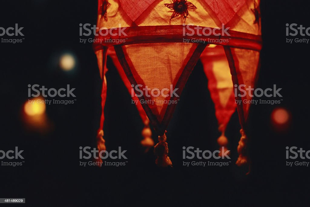 Red shades lamp on a dark background in Goa, India stock photo