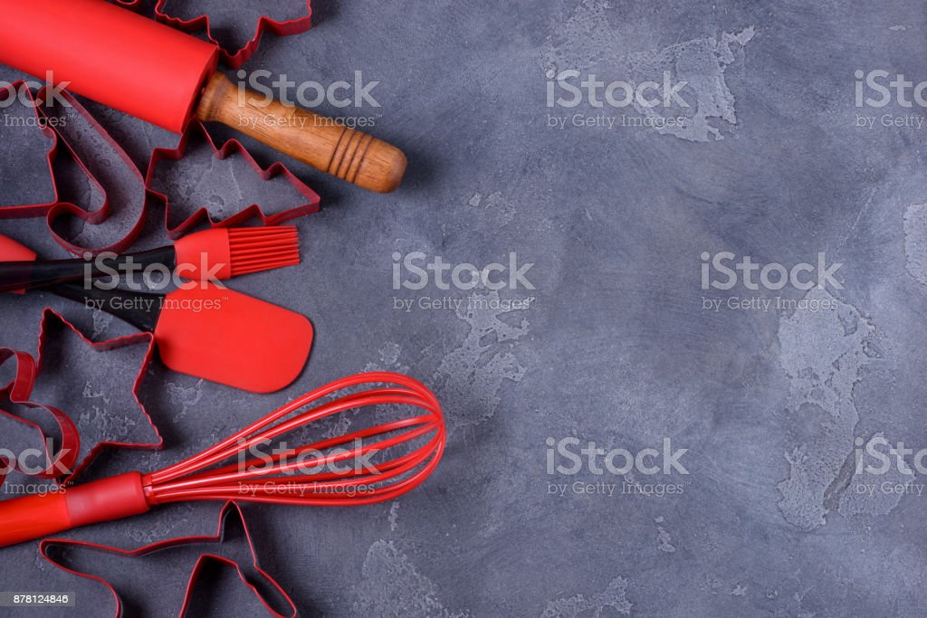 Red shapes pastry cutters and kitchen utensils stock photo