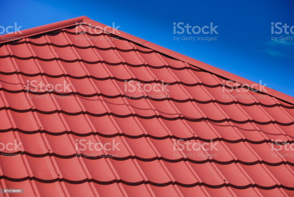 Red sheet metal roof tile stock photo