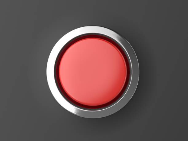 red shiny button with metallic elements isolated on black background - button stock photos and pictures