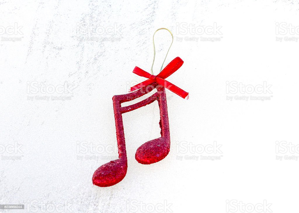 Christmas Music Notes.Red Shiny Decorative Christmas Music Notes Stock Photo Download Image Now