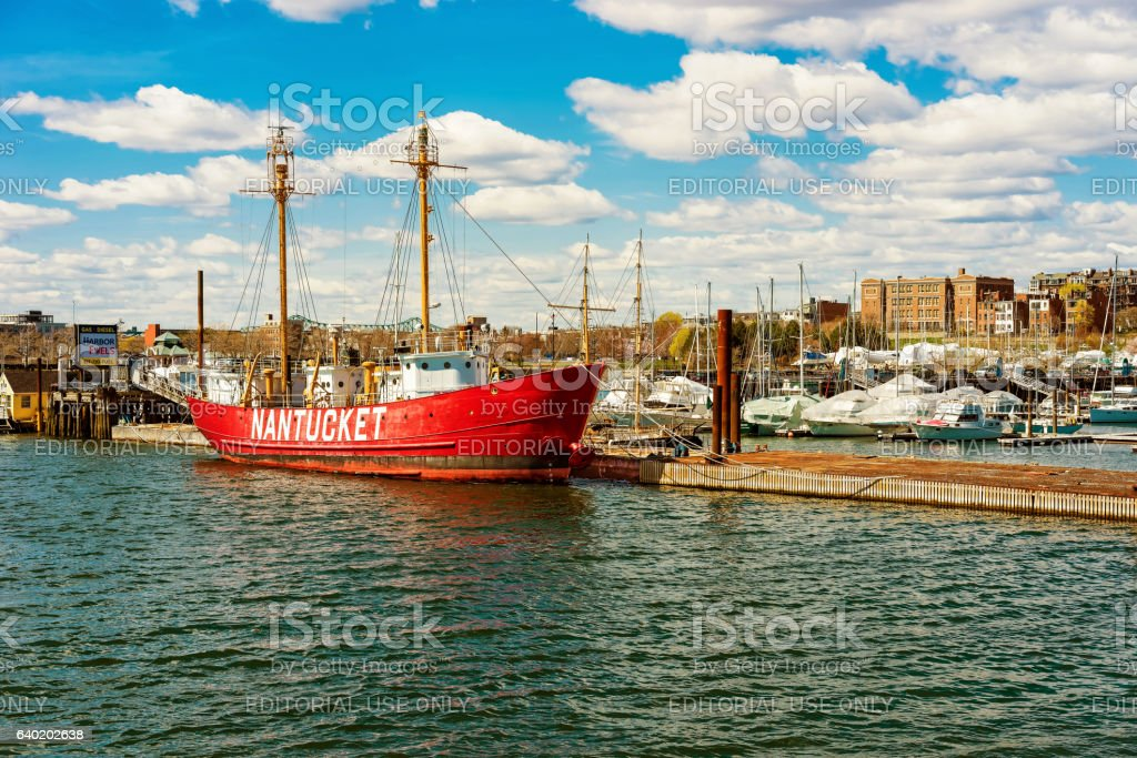 Red ship moored at the bay in Boston stock photo