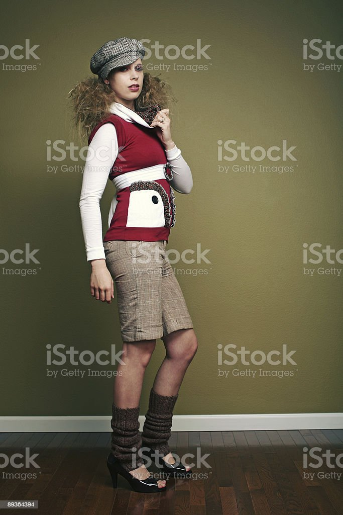 Red Shirt Blonde in Shorts and Leg Warmers royalty-free stock photo