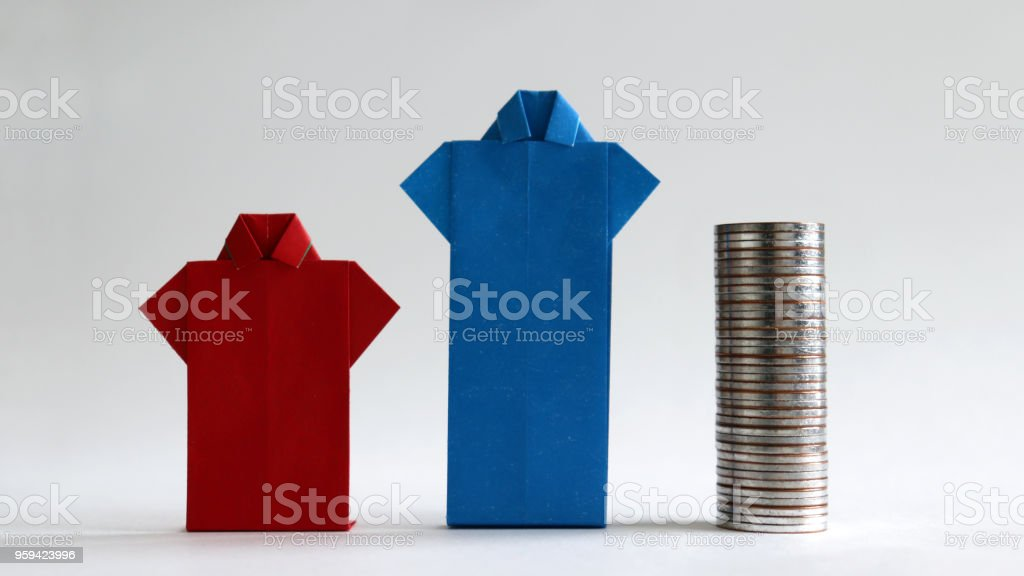 Red shirt made of paper and a pile of coins next to the blue shirt. The concept of a gender pay gap. stock photo