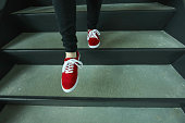 istock Red shoes going down stairs 686051210