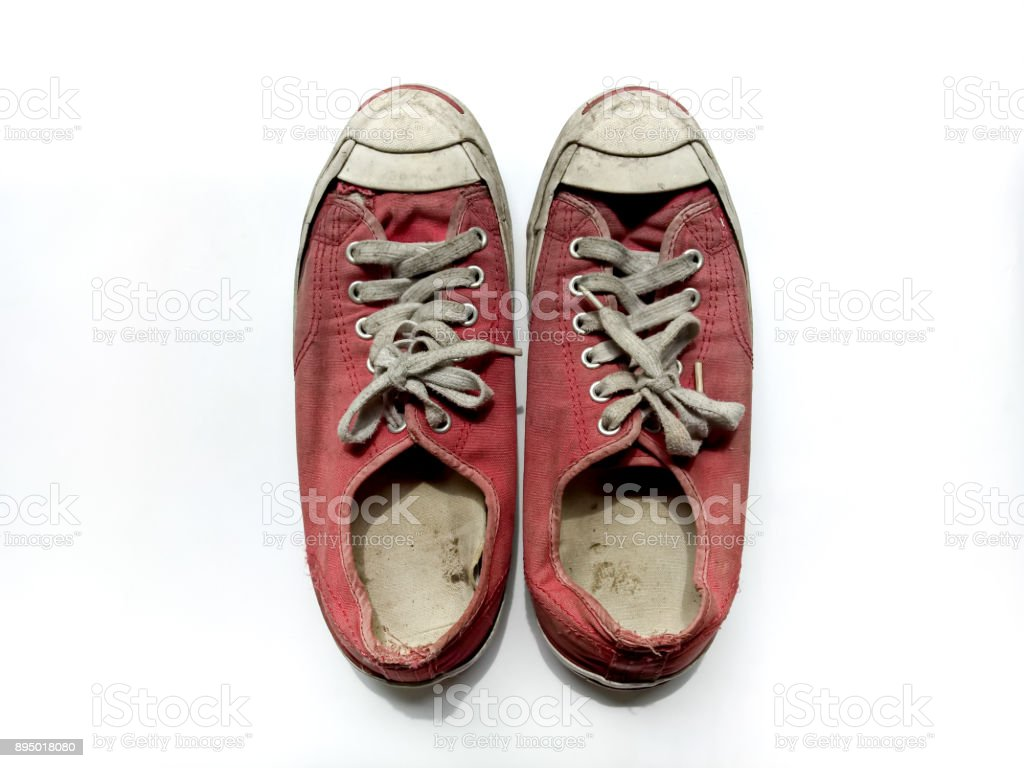 Red shoes is dirty on white background stock photo